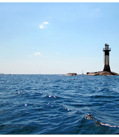 Lighthouse in the blue sea
